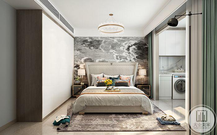 卧室床头背景墙是黑白灰的云纹,整体色调也是简单的黑白米色,随性舒适
