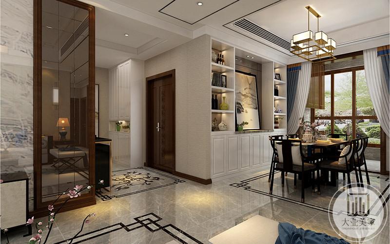 餐厅是六人桌椅,大大的落地窗使餐厅显得十分明净,后面背景墙是壁柜样式,摆放着插画和摆件