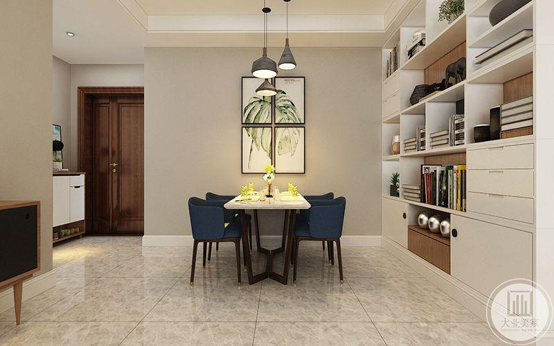 餐厅除了简单的餐桌椅之外主要用作作收纳空间,一面收纳格子柜就在餐桌后方