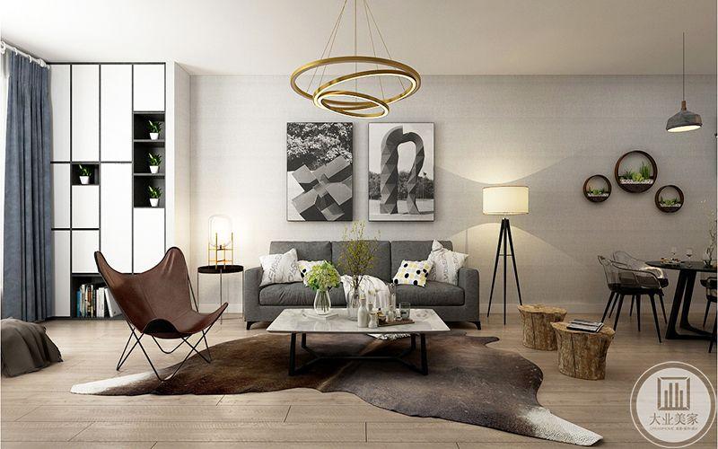 客厅沙发背景墙是两幅艺术画,沙发是灰色的布艺沙发
