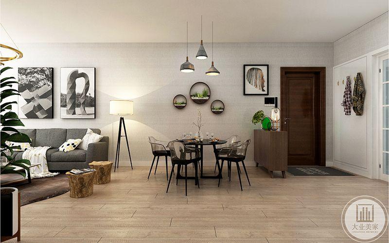房子入门左手边墙面有弱电盒,通过挂衣墙板造型处理,美化墙面的同时解决挂衣问题。入门做半高的简易鞋柜,最大限度的保持房间的通透性。