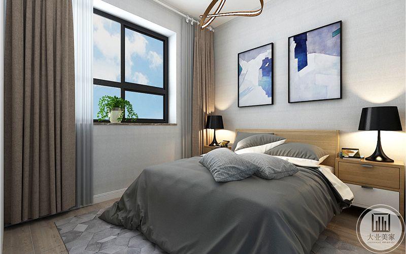 次卧是简单的单人床和木质橱柜
