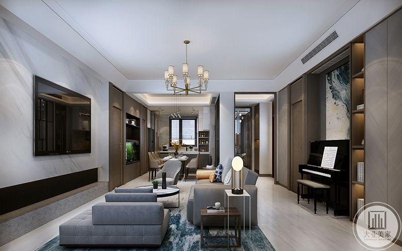 客厅电视墙采用了简洁的白色大理石板,左下角用木质材料设置了一个L形的边框,在简单中透出设计感,简单的大理石地板上是同样简约的沙发和茶几,浅灰色的布艺沙发柔软舒适,慵懒随意
