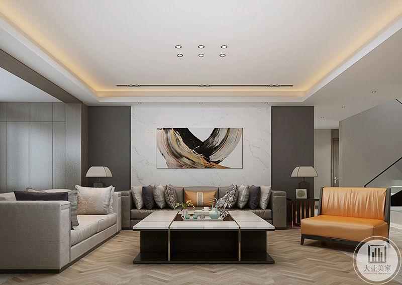 客厅沙发墙是简约的白色大理石板,中间是一幅简约的艺术画,客厅基本是黑白灰的色调,另外添了一抹橘色来提亮,使客厅不至于显得单调