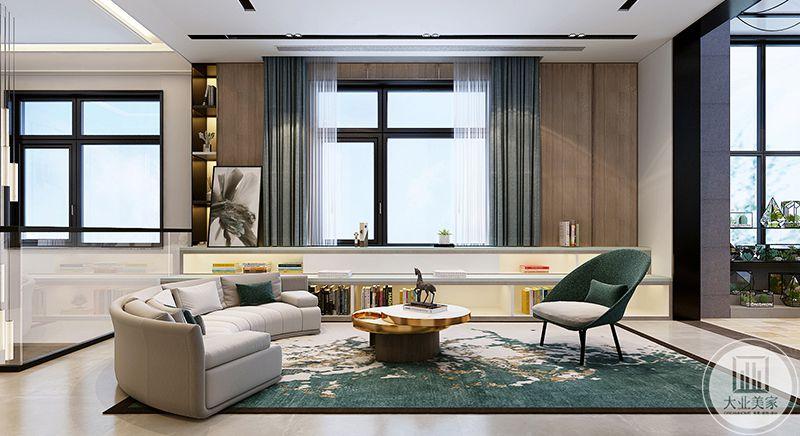 楼上这一个客厅是以蓝绿色为主色调,构思是大海的自由感。蓝绿色的地毯上是白色的布艺软沙发,旁边两排低矮的书架,在这里可以舒适的在知识的海洋中自由泳