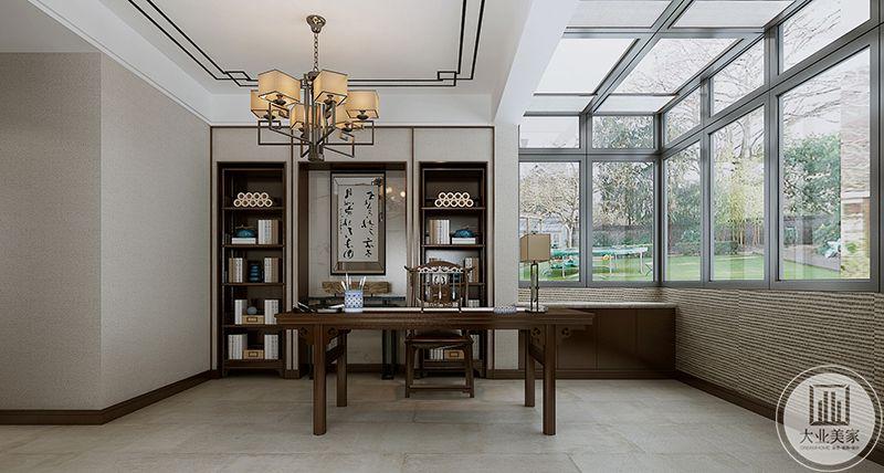 这一件书房则是新中式的样式,深色的木桌木椅朴实自然