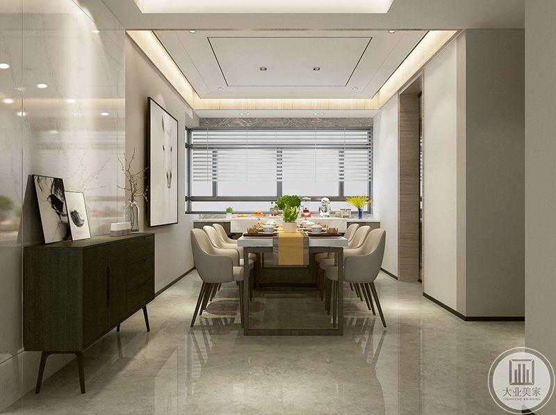 餐厅的长桌是大理石台面,在整体米白色的色调让人不由自主的感觉十分温馨,大大的窗户十分明净