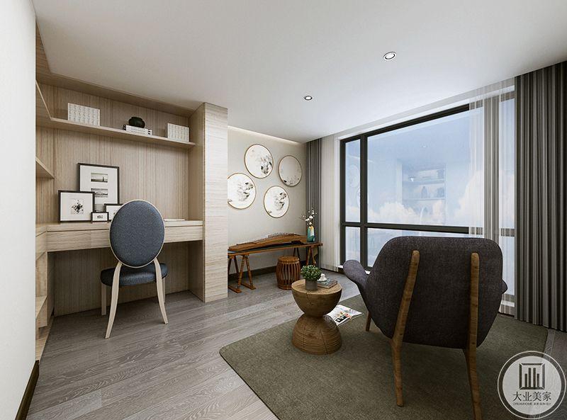 休闲室应业主要求,单独摆放了古筝,一个简约的书桌位于一角,另有一个大大的单人软沙发在窗边
