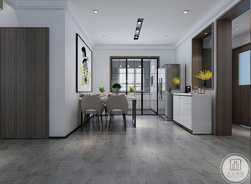餐厅与厨房用一扇玻璃门隔开,餐桌靠墙,墙上是一幅现代画,右侧则是冰箱和一个收纳柜