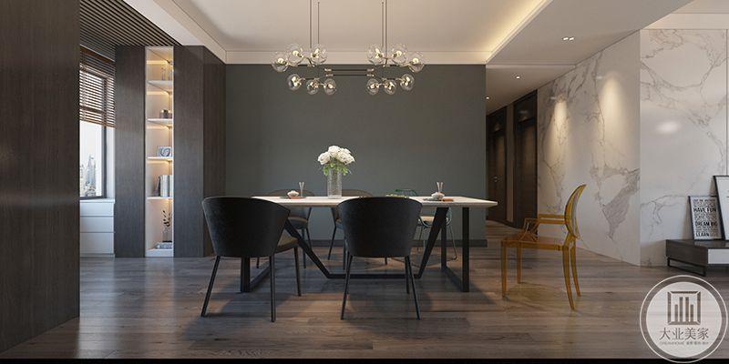 餐厅正式图更显精致简约,灰色的漆面与深色的餐椅相得益彰,餐桌上精致的白色插花小清新感十足,给淡漠的餐厅空间增添了一丝甜意
