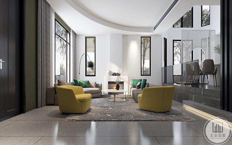 一层客厅以浅灰色系为主要色调,另外添加鹅黄的单人沙发和墨绿色的抱枕使原本淡漠的空间多了几丝生机。