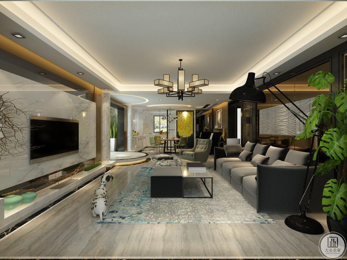 .影视墙采用白色大理石,摈弃了传统的电视机柜,采用连体的大理石地台,简洁大气
