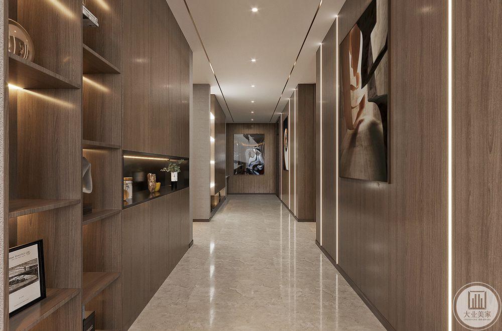 考虑到原始户型的走廊动线明朗,因此采用石材搭配引导型的线型灯的设计手法