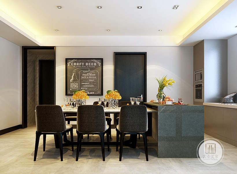 餐厅的餐桌餐椅采用现代风格,一侧的中岛采用大理石桌面,一侧的墙面采用小黑板做装饰画。