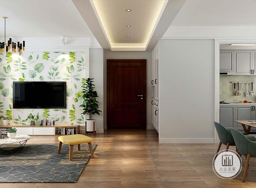 入户空间采用白色衣柜,另一侧是开放式厨房的一部分。