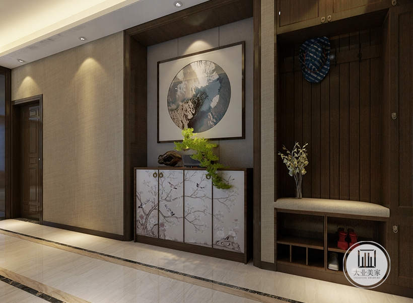 入户空间采用浅黄色壁纸,墙面采用灰色壁布,橱柜采用灰色橱柜。
