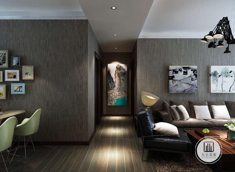 暗色调设计上强调功能结构和形式的完整,装饰挂画以及一些家居摆件的运用,以色彩的高度凝练和造型的极简前提下,将空间合理精致的美化。