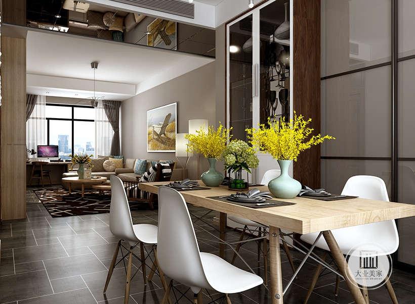 客厅与餐厅以及走廊尽头的造型墙设计以及灯带的漫反射塑造的层次感是本案设计连贯场景和空间的重要锁链。木质餐桌,加上鲜花点缀,给用餐者回归自然,悠然室外的独特感受。