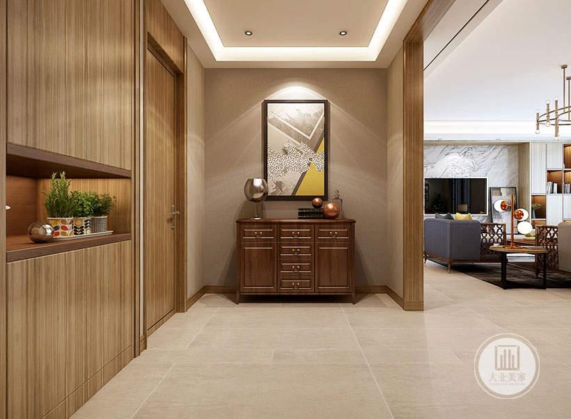 入户玄关墙面铺贴浅灰色壁纸,搭配实木边柜。