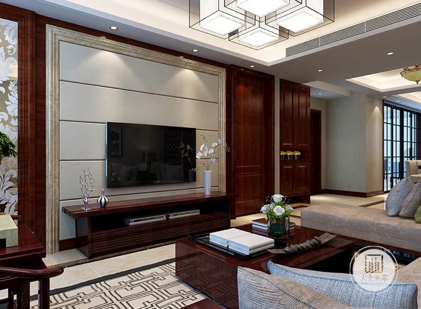 黑色电视机下方实木电视柜,与桌台为同一材质,红木乃是传统风格中不可缺少的一类装饰,可以烘托居室氛围,更好的表现古典家具的内涵。