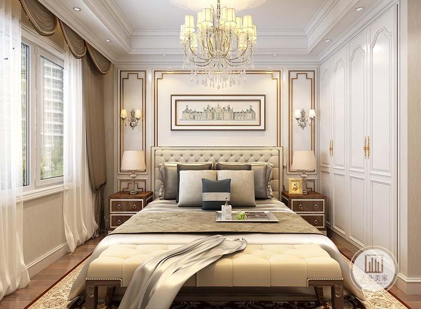主卧室床头背景墙采用白色装饰,悬挂欧式建筑装饰画,床的两侧采用棕色床头柜装饰。