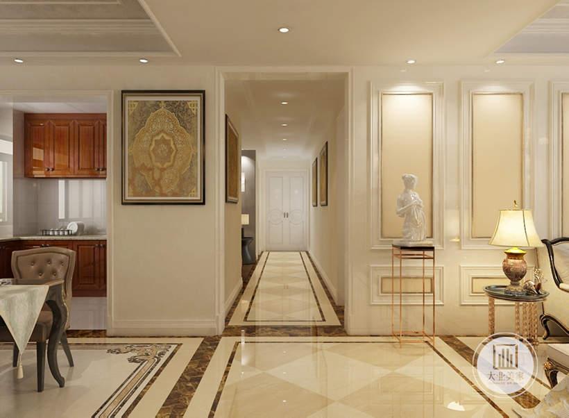 从这里可以看到入户走廊空间墙面以白色为主,墙面采用浅黄色装饰画。