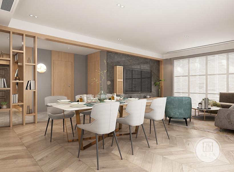 餐厅和客厅空间融合在一起,餐桌采用现代风格装饰,餐椅采用灰色所料,影视墙采用灰色大理石材料,电视柜采用实木材料。