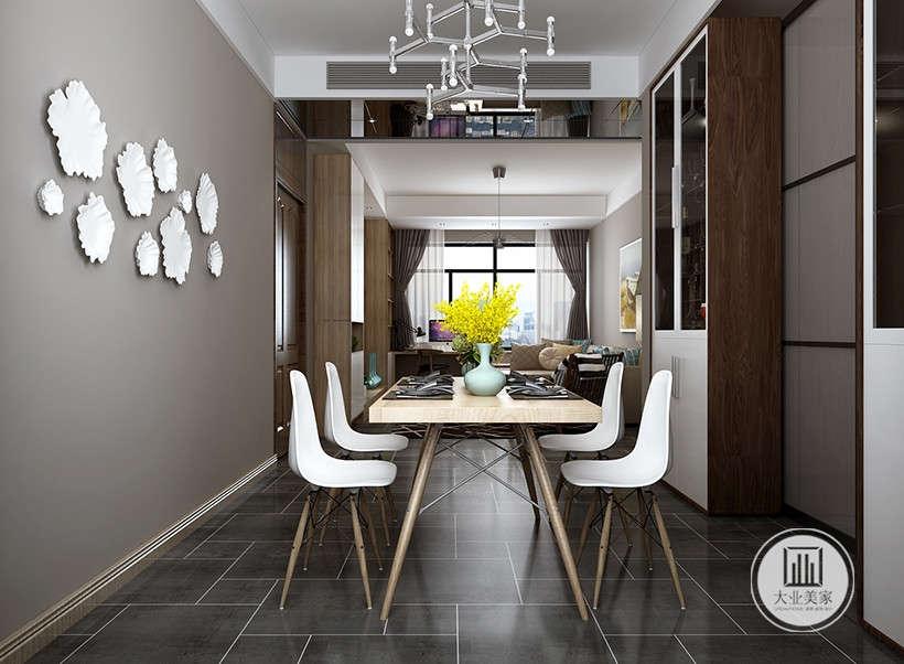 现代工艺品的巧妙运用,将时尚前卫的风格发挥到极致,灰咖色墙面点缀白色贝壳造型设计,素雅大气,冷淡黑白色系,彰显居住者简单纯净的心态,淡黄色清新花植又冲淡装修冷意,为室内带来一丝活力。