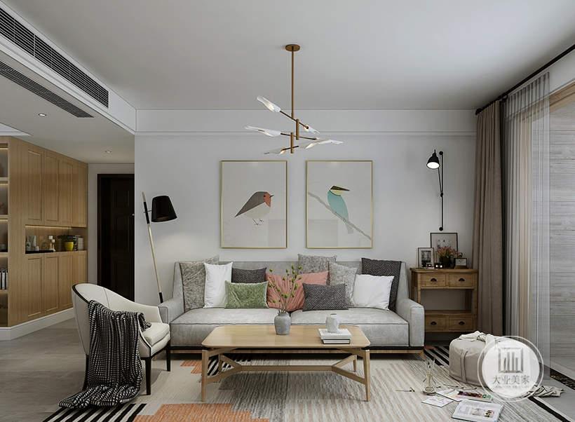 客厅影视墙不做任何颜色装饰,墙面悬挂两幅现代装饰画,沙发采用灰色布艺沙发,茶几采用实木茶几,地面铺设深灰色木纹砖搭配浅黄色地毯。