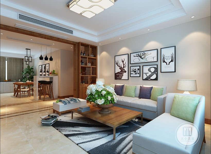 简约风格装饰画,纯色沙发搭配棕红,翠绿色抱枕,这样的色彩搭配可以营造出华丽的视觉感觉。