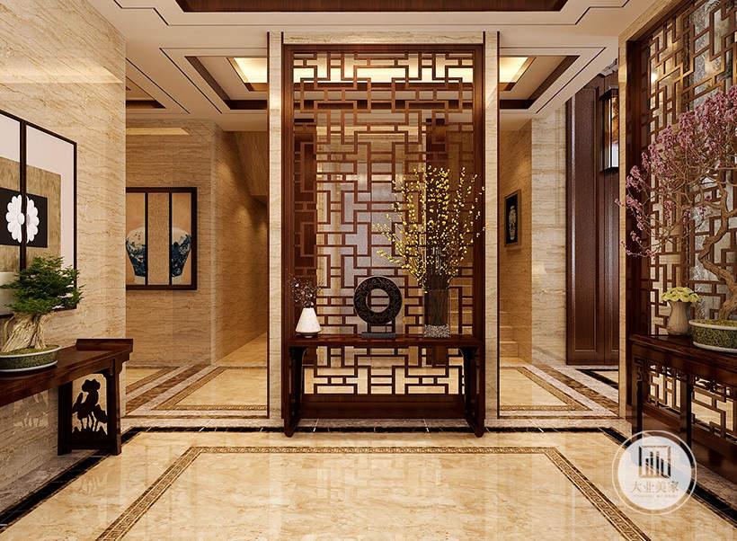 玄关装修效果图:玄关采用红木镂空格栅,搭配红木书桌,一侧的墙面使用木纹砖。