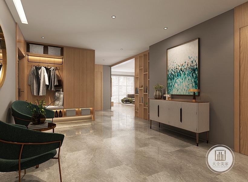 入户空间采用绿色座椅搭配现代黑色茶几,沙发相对墙面采用深灰色涂料,搭配绿色装饰画浅灰色橱柜。