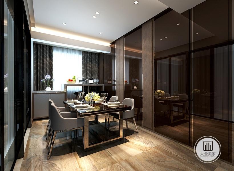简约不是直白地简单,在设计师深思熟虑后经过创新餐桌和餐椅采用同款材质,顶部安装射灯,看似不规则却蕴含深意,投射灯光的角度与位置都是精心对比后的确定,不同光源的变换,为室内带来不同的用餐氛围。