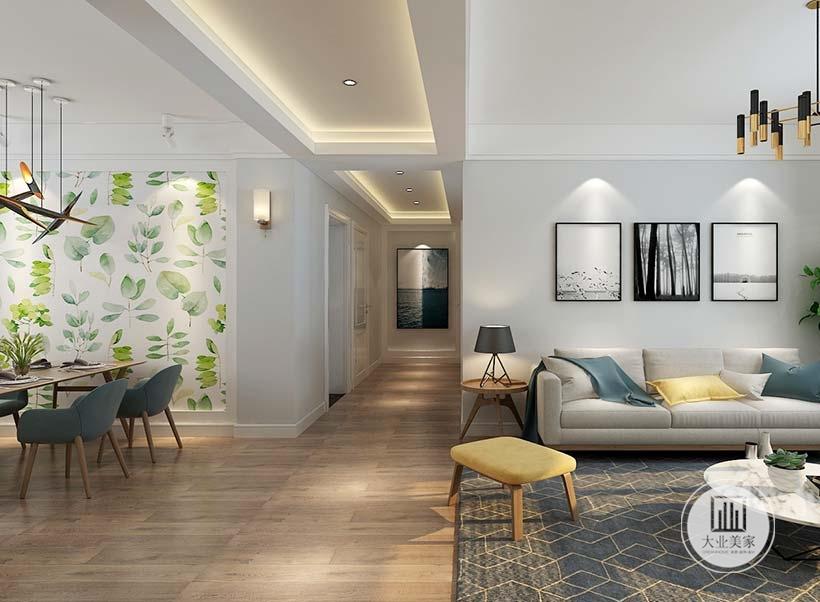 沙发背景墙面采用浅灰色壁纸,客厅沙发采用灰色布艺装饰,地面铺设浅色木地板,搭配深蓝色地毯。