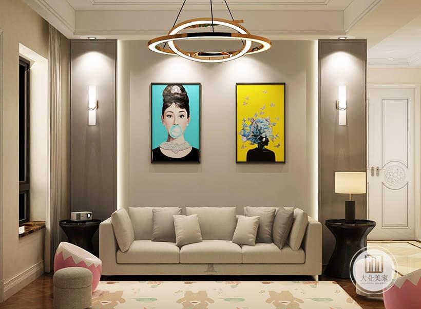 地下影视厅的沙发墙铺贴灰色壁纸,墙面采用双幅现代装饰画,地面铺设深色木地板搭配白色地毯。